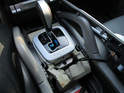 Maneuver the center console panel around the gearshift knob and place it off to the side.