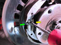 Once you have removed the rear brake rotor, you'll need to start disassembling the parking brake.