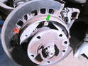 Now remove the top retaining pin and remove the brake shoe (green arrow).