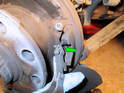 When installing the new brake shoes, first take note of the orientation of the cable clevis (green arrow).