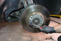 Now remove the T50 Torx screw that secures the brake rotor to the hub.