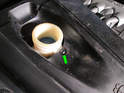 Don't forget to also remove the small T20 Torx screw (green arrow) that secures the reservoir filler neck to the cover.