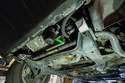 Shown here is the oil filter housing cover (green arrow).