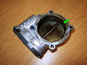 Shown here is the buildup of carbon and oil sludge on the backside of the throttle body.