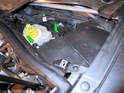 Pull the two fuse panel cover pins up (green arrows) up and out of the fuse box and remove the cover.