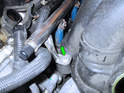 Remove the front right T30 Torx screw (green arrow) holding the fuel rail to the intake manifold.