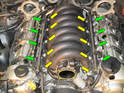 Loosen each T40 bolt holding the intake manifold to the engine (yellow arrows) The bolts are held captive in the manifold, so don't worry about pulling them out, just loosen them.
