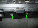 Now remove the two T20 screws holding the catch to the glove box assembly (green arrows).