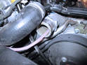Now remove each radiator hose and stick the hose down into the thermostat housing.