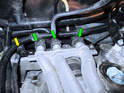 Now loosen the hose clamps holding the water lines to the coolant tubes (green arrows).