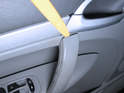 Use a plastic pry bar to gently pop the cover off the arm rest handle.