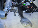 Fit the new brake light switch in the hole while the brake pedal is pulled fully back towards the rear.