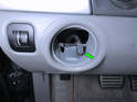 Try not to let the electrical connector (green arrow) fall back inside the dashboard.