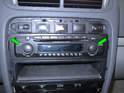 Now remove the T10 Torx screws holding the stereo to the dashboard frame (green arrows).