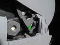 ThisPicture shows the part of the clip (green arrow) that needs to slide over the retaining bolt.