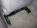 Now move the seat all the way forward and remove the two 10mm XZN bolts holding the rear of the rails to the seat frame (green arrows).