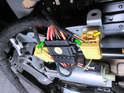 Now press the tabs (green arrows) inward on the main harness connector and pull it off the seat.