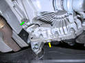 Shown here are the drain (yellow arrow) and fill (green arrow) plugs on the transfer case.
