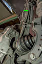 Front Brake Lines - Left and Right Sides: Shown here is the front brake line (green arrow) on the Porsche Cayenne.