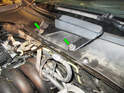 Loosen and remove the two 16mm nuts (green arrows) holding the wiper arms to the motor/linkage shafts.