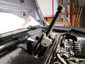 You'll need a small two-arm puller in order to remove the arms from the motor/linkage assembly.
