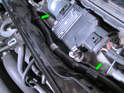 Pry open the wiring harness retainers (green arrows) on the wiper motor/linkage assembly and carefully pull the wiring harness up enough to allow the motor to be rotated up out of the engine bay.