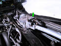 Now press the tab on the electrical connector (green arrow) and pull it off the wiper motor/linkage assembly.