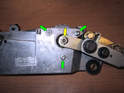 Turn the motor over and remove the three T30 Torx screws (green arrows) holding the motor to the linkage assembly.