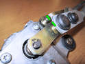 Adjust the drive arm so that there is 4mm of clearance between the edge of the arm and the mechanical stop (green arrows) before fitting the 13mm nut.