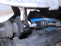 Hold the shaft of the upper end link ball joint by inserting a T40 Torx driver while loosening the 16mm nut.