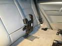 Shown here is the seat belt bracket folded upward.