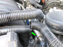 Shown here is the common culprit, one of the breather hoses is broken in half (green arrow).