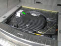 Shown here is the option code build sheet sticker located in the rear cargo area under the access panel (green arrow).