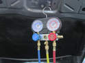 A Manifold gauge set as shown here gives you the ability to further diagnose AC problems.