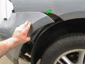 Left and Right Sides: Carefully pull the edge of the bumper cover (green arrow) rearward to release it from the mounting clips on the chassis.