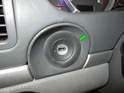 Remove the rubber trim piece around the lock cylinder (green arrow).