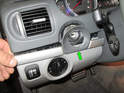 Now carefully pry the plastic trim piece (green arrow) off from the dashboard.