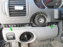 Loosen and remove the two T20 Torx (green arrow) screws holding the right side of the panel to the dashboard.