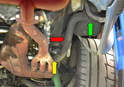 This photo illustrates the S-hose (red arrow) that connects to the oil tank (green arrow) and the motor at the bottom of the oil cooler (yellow arrow).