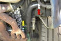 Install the new S-hose between the tank and engine.