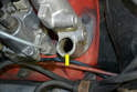 Stuff a rag into the injector port and clean the opening in the intake runner (yellow arrow) using care to make sure nothing falls into the runner.