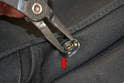 To remove the old cap use a set of circlip pliers and insert them into the two openings on the back of the cap (red arrow).