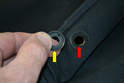 Remove the backing plate (yellow arrow) and push the old cap out from the cover (red arrow).
