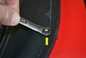 To remove the stud use a 9mm wrench and unscrew it form the body (yellow arrow).
