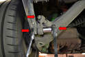 Use a 19mm wrench or socket and remove the bolts holding the drop links (red arrows).