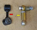 This photo illustrates the difference between the stock link (red arrow) and the Tarett adjustable drop link (yellow arrow).