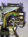 When the lever is in the neutral position, the center contact is toggled upward against the top contact (yellow wire).
