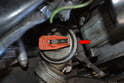 Since you have removed the distributor cap you can make sure that the number 1 cylinder is at TDC by having the rotor line up with the mark on the distributor (red arrow).