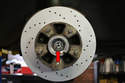 Now fit the wheel hub back over the spindle and push it back until the seal pops over the flange on the back of the spindle.