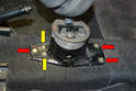 Place the shifter in third gear and remove the two 10mm bolts and washers and three 13mm bolts and washers (red arrows).